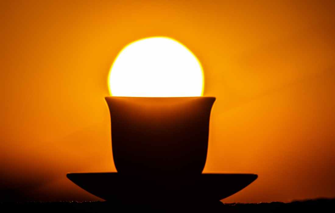 silhouette of teacup on saucer during sunset
